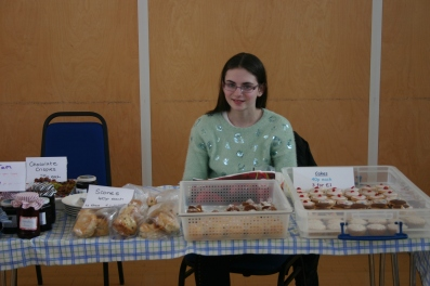 Sophie selling cakes
